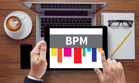bpm: BPM - Business Process Management , on the tablet pc screen held by businessman hands - online, top view