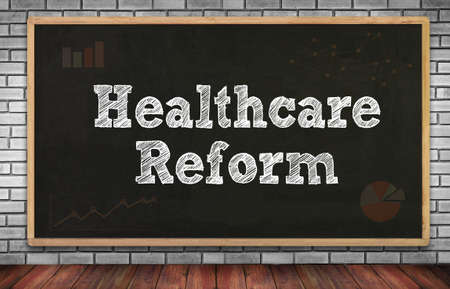 reform: Healthcare Reform on brick wall and chalkboard background Stock Photo