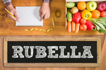 rubella: RUBELLA fresh vegetables and  on a wooden table Stock Photo