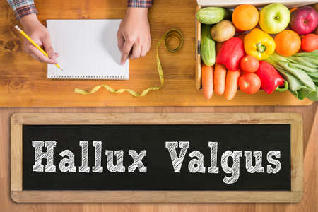 bunion: Hallux Valgus fresh vegetables and  on a wooden table Stock Photo