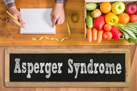 asperger syndrome: Asperger Syndrome fresh vegetables and  on a wooden table Stock Photo