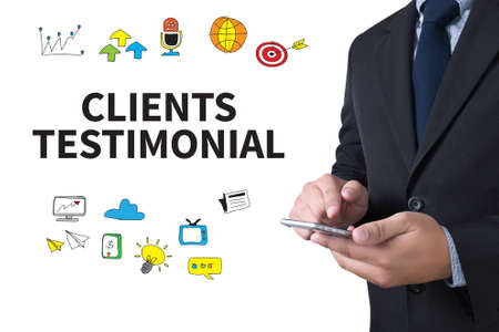 affirmations: CLIENT TESTIMONIAIS businessman working use smartphone Stock Photo