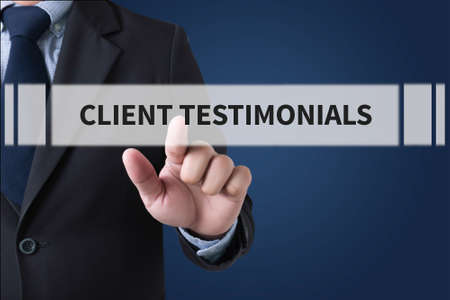 CLIENT TESTIMONIALS Businessman hands touching on virtual screen and blurred city background