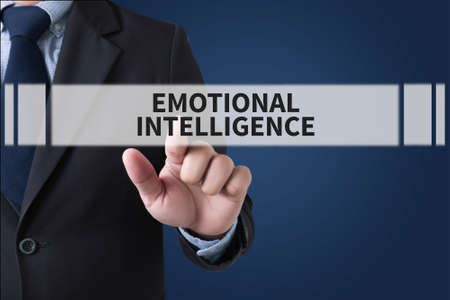 decreased: EMOTIONAL INTELLIGENCE Businessman hands touching on virtual screen and blurred city background