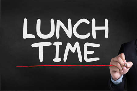 regenerate: LUNCH TIME Businessman drawing Landing Page on blackground Stock Photo