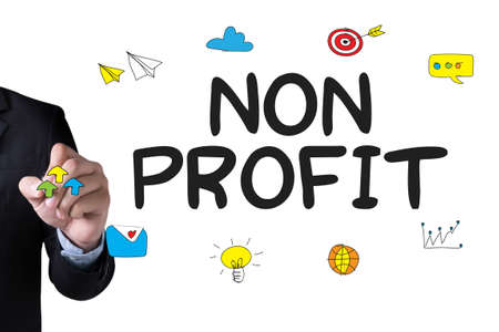 non profit: NON PROFIT and Businessman drawing Landing Page on white background