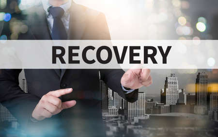 data recovery: RECOVERY (Recovery Backup Restoration Data) and businessman working with modern technology Stock Photo