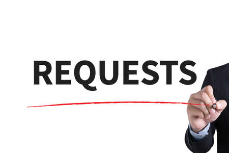 solicit: REQUESTS Businessman hand writing with black marker on white background Stock Photo