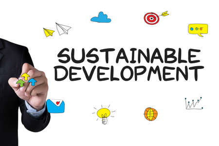 economic theory: SUSTAINABLE DEVELOPMENT and Businessman drawing Landing Page on white background