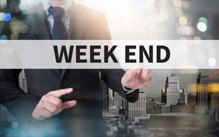 working week: WEEK END and businessman working with modern technology Stock Photo