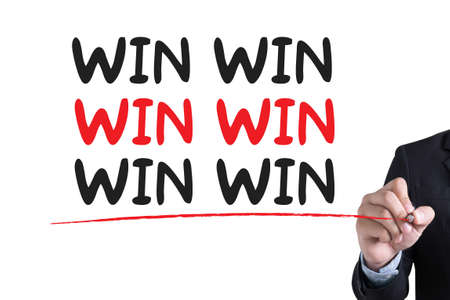 hand writing: WIN WIN  Businessman hand writing with black marker on white background Stock Photo