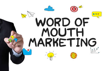 referrer: WORD OF MOUTH MARKETING and Businessman drawing Landing Page on white background Stock Photo