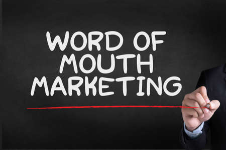 referrer: WORD OF MOUTH MARKETING Businessman drawing Landing Page on blackground