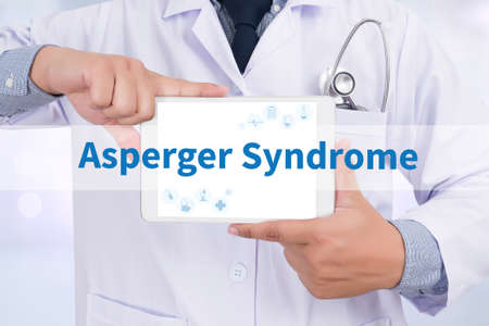 asperger syndrome: Asperger Syndrome Doctor holding  digital tablet Stock Photo