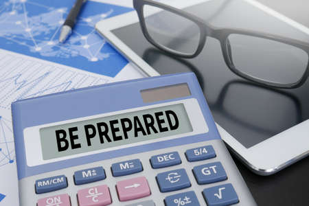 be prepared: BE PREPARED concept Calculator  on table with Office Supplies. Stock Photo