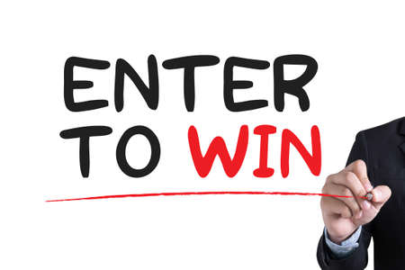 contestant: ENTER TO WIN Businessman hand writing with black marker on white background
