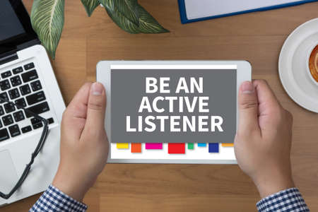 listener: BE AN ACTIVE LISTENER man hand Tablet and coffee cup