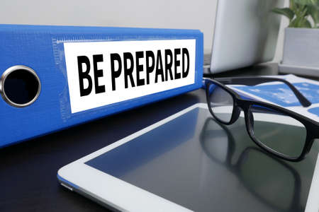 be prepared: BE PREPARED concept Office folder on Desktop on table with Office Supplies. Stock Photo