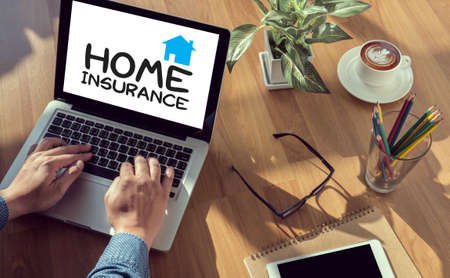 homeowners insurance: HOME INSURANCE man hand on table Business, coffee, Split tone
