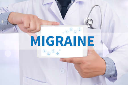 drowsiness: MIGRAINE Doctor holding  digital tablet