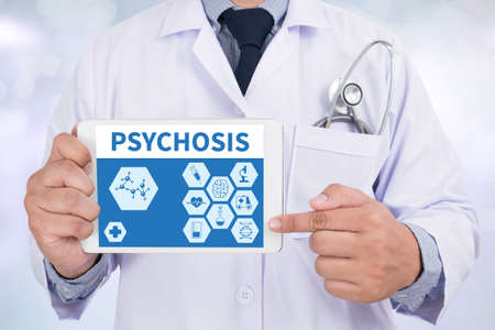 psychopathy: PSYCHOSIS Doctor holding  digital tablet