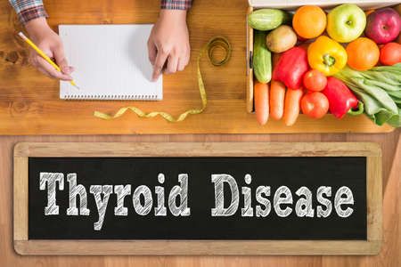 Thyroid Disease fresh vegetables and  on a wooden table