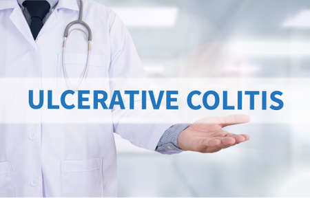 colitis: ULCERATIVE COLITIS Medicine doctor hand working Stock Photo