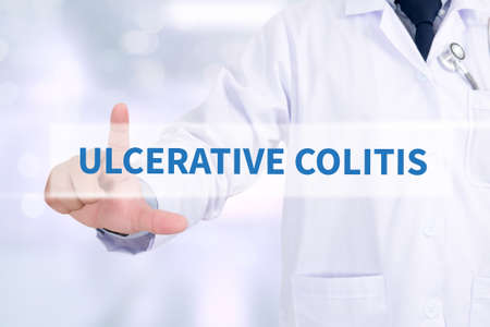 colitis: ULCERATIVE COLITIS Medicine doctor working with computer interface as medical
