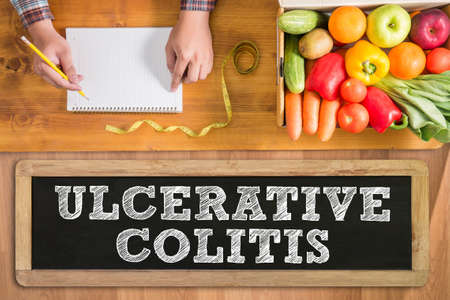 ULCERATIVE COLITIS fresh vegetables and  on a wooden table
