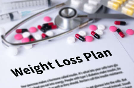weight loss plan: weight loss plan and Background of Medicaments Composition, Stethoscope, mix therapy drugs doctor and selectfocus Stock Photo