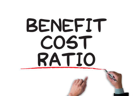 ratio: BENEFIT COST RATIO businessman work on white broad, top view