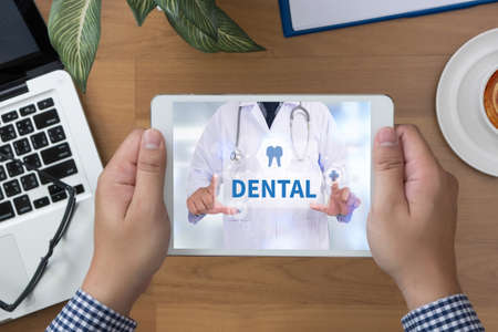 dental insurance: DENTAL INSURANCE man hand Tablet and coffee cup