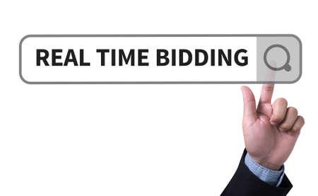 bidding: REAL TIME BIDDING man pushing (touching) virtual web browser address bar or search bar Stock Photo
