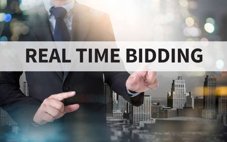 bidding: REAL TIME BIDDING and businessman working with modern technology