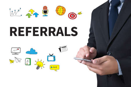 endorsement: REFERRALS Business team hands at work Stock Photo