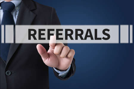 referral: REFERRALS Business team hands at work Stock Photo