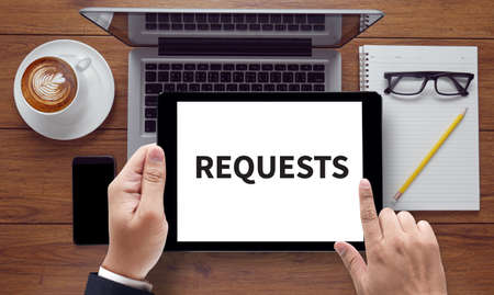 solicit: REQUESTS, on the tablet pc screen held by businessman hands - online, top view