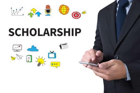 scholarship: SCHOLARSHIP businessman working use smartphone Stock Photo