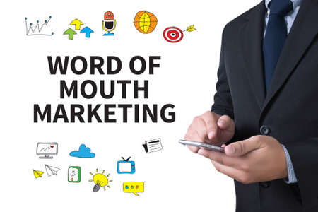 referrer: WORD OF MOUTH MARKETING businessman working use smartphone Stock Photo