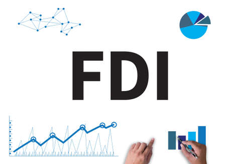 FDI      Foreign direct investment businessman work on white broad, top view