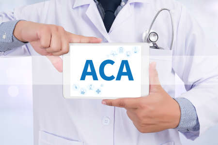 affordable: ACA   (Affordable Care Act) Doctor holding  digital tablet Stock Photo