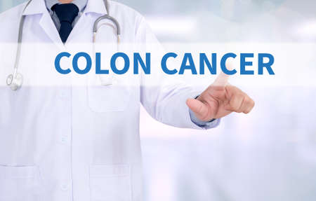 rectum cancer: COLON CANCER Medicine doctor working with computer interface as medical Stock Photo