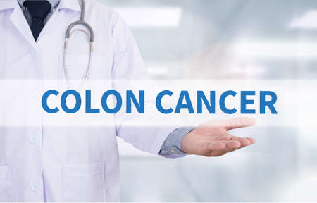 colonoscopy: COLON CANCER Medicine doctor hand working Stock Photo