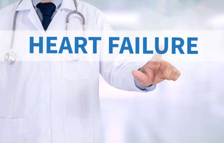 heart failure: HEART FAILURE Medicine doctor working with computer interface as medical Stock Photo
