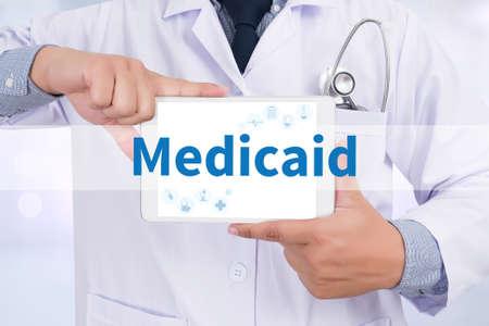 medicaid: Medicaid Doctor holding  digital tablet Stock Photo