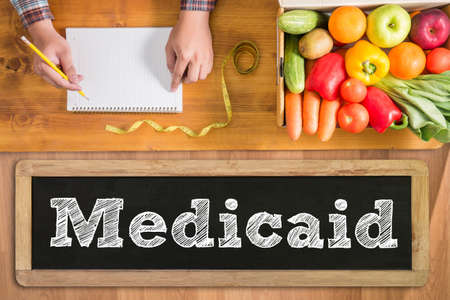 medicaid: Medicaid fresh vegetables and  on a wooden table