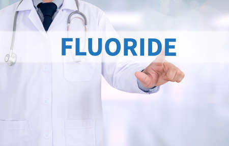fluorine: FLUORIDE Medicine doctor working with computer interface as medical