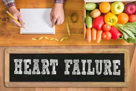 heart failure: HEART FAILURE fresh vegetables and  on a wooden table Stock Photo