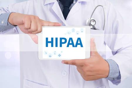 HIPAA Doctor holding  digital tablet