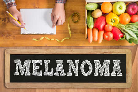 insolación: MELANOMA fresh vegetables and  on a wooden table Foto de archivo